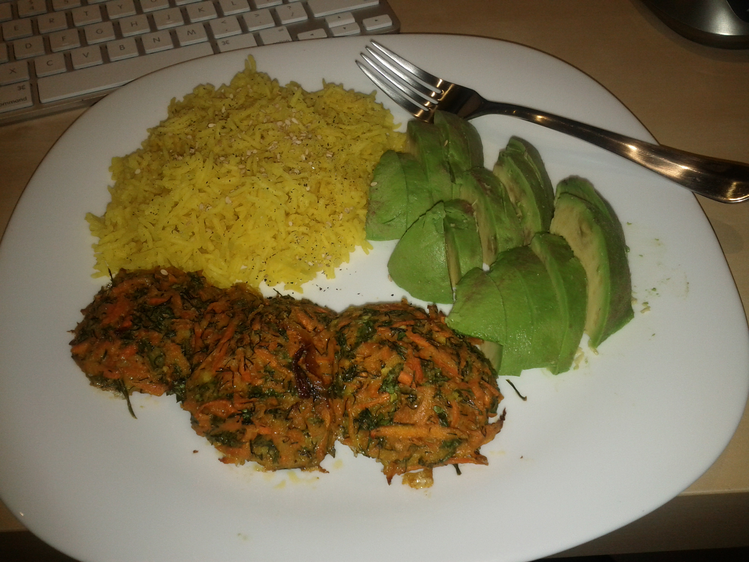 Baked carrot latkes with yellow rice and avocado